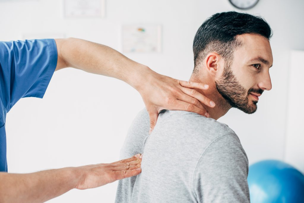 Man being examined by pain doctor at Chiropractic Office Clearwater.